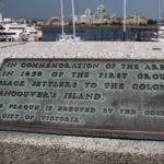 bronze plaque inlaid on top of concrete causeway wall